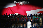 Sir Bradley Wiggins gives the thumbs up as he poses alongside his Wiggins Team during the Presentations at the Westin Hotel ahead of the Tour of...