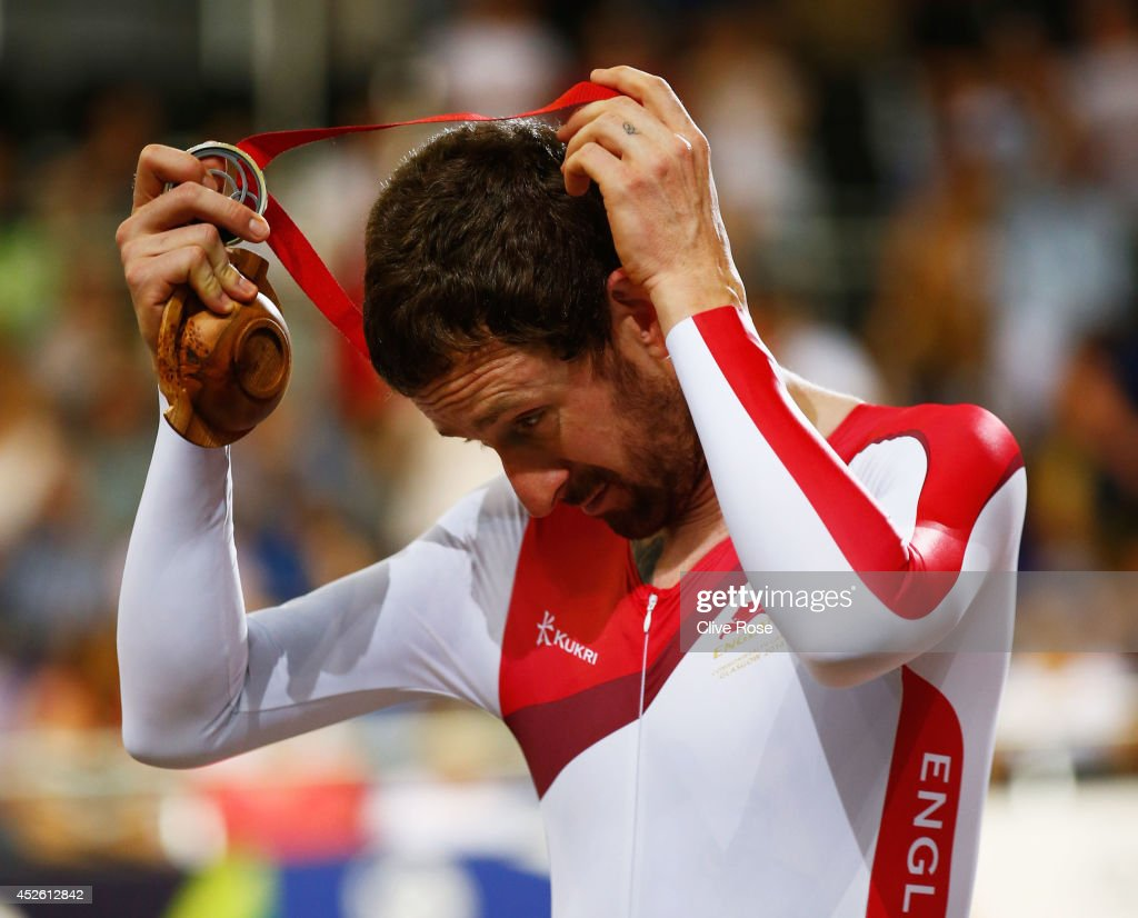 Sir <a gi-track='captionPersonalityLinkClicked' href=/galleries/search?phrase=Bradley+Wiggins&family=editorial&specificpeople=182490 ng-click='$event.stopPropagation()'>Bradley Wiggins</a> of England takes off his silver medal during the medal ceremony for the Men's 4000 metres Team Pursuit final at Sir Chris Hoy Velodrome during day one of the Glasgow 2014 Commonwealth Games on July 24, 2014 in Glasgow, Scotland.