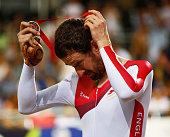Sir Bradley Wiggins of England takes off his silver medal during the medal ceremony for the Men's 4000 metres Team Pursuit final at Sir Chris Hoy...