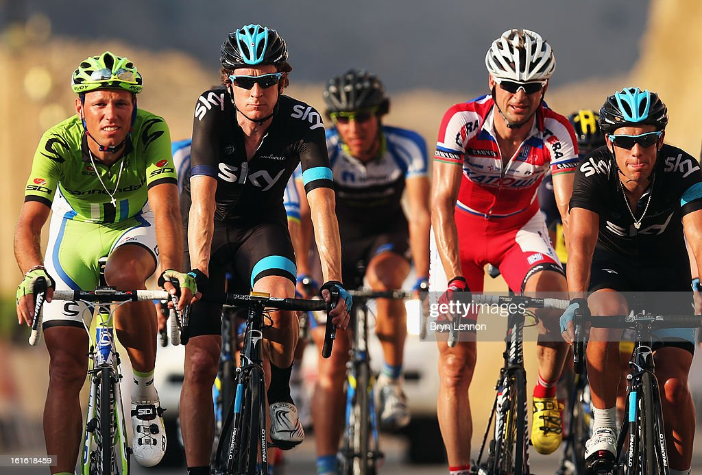 Sir Bradley Wiggins (2nd left) of Great Britain and SKY Procycling crosses the finishline on stage three of the 2013 Tour of Oman from Nakhal Fort to Wadi Dayqah Dam on February 13, 2013 in Wadi Dayqah Dam, Oman.