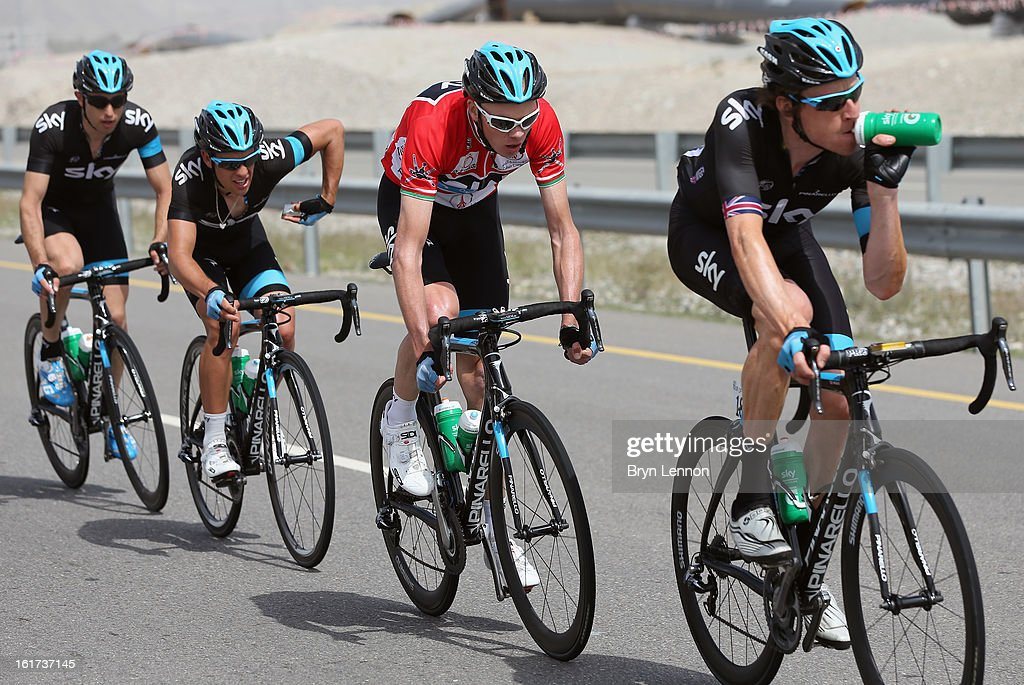 Sir Bradley Wiggins of Great Britain and SKY Procycling leads team mate and race leader Chris Froome during stage five of the Tour of Oman from Al Alam Palace to the Ministry of Housing in Boshar on February 15, 2013 in Boshar, Oman.