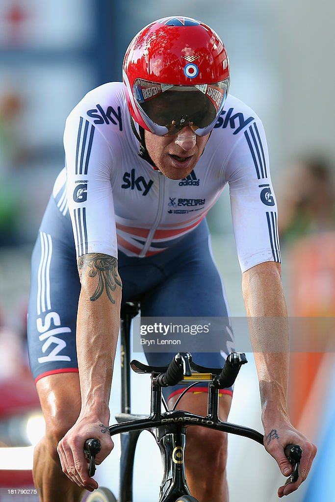 Sir Bradley Wiggins of Great Britain crosses the finish line in second place during the Elite Men's Time Trial, from Montecatini Terme to Florence on September 25, 2013 in Florence, Italy.