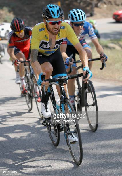 Sir Bradley Wiggins of Great Britain riding for Team Sky defends the overall race leader's yellow jersey as Rohan Dennis of Australia riding for Team...