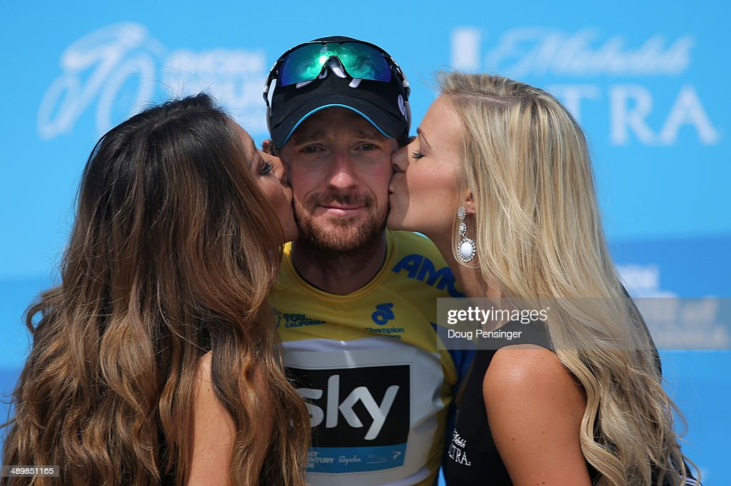 Sir Bradley Wiggins of Great Britain riding for Team Sky is awarded the overall race leader's jersey after winning the individual time trial in stage...