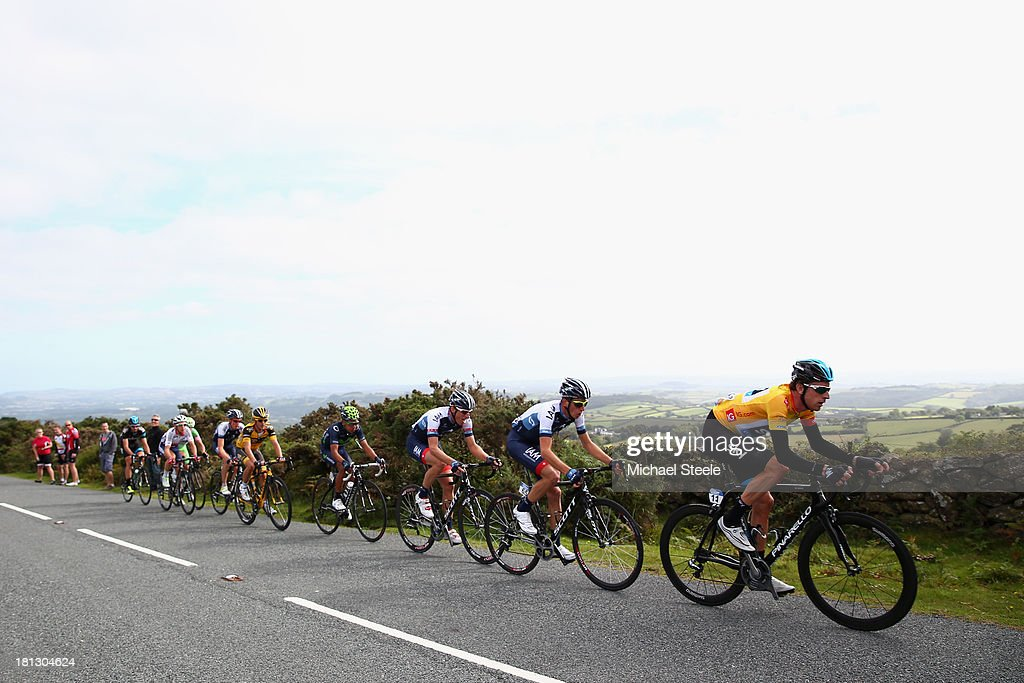 Sir <a gi-track='captionPersonalityLinkClicked' href=/galleries/search?phrase=Bradley+Wiggins&family=editorial&specificpeople=182490 ng-click='$event.stopPropagation()'>Bradley Wiggins</a> (R) of Team Sky Procycling wearing the gold leaders jersey leads up the final kilometre on Haytor during stage six of the Tour of Britain from Sidmouth to Haytor on September 20, 2013 in Sidmouth, England.