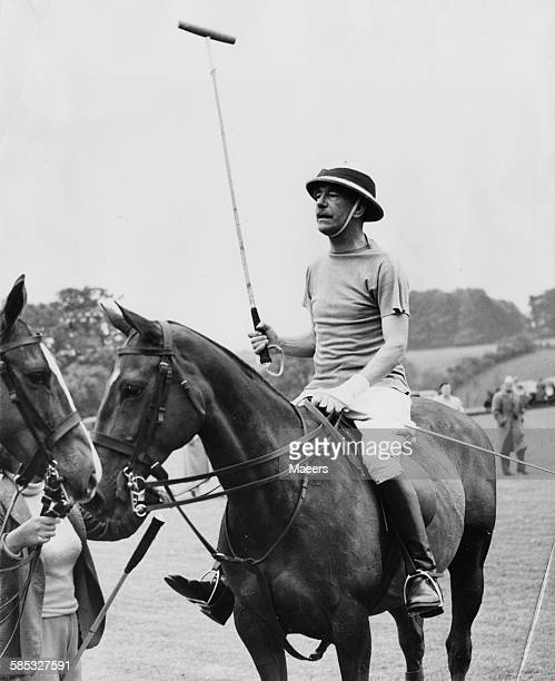 Sir Brian Robertson Chairman of the British Transport Commission pictured on horseback between chukkas during a polo match at Cirencester Park May...