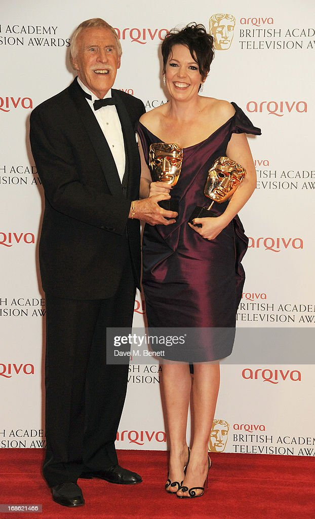 Sir Bruce Forsyth (L) and Best Female in a Comedy winner Olivia Colman pose in the press room at the Arqiva British Academy Television Awards 2013 at the Royal Festival Hall on May 12, 2013 in London, England.