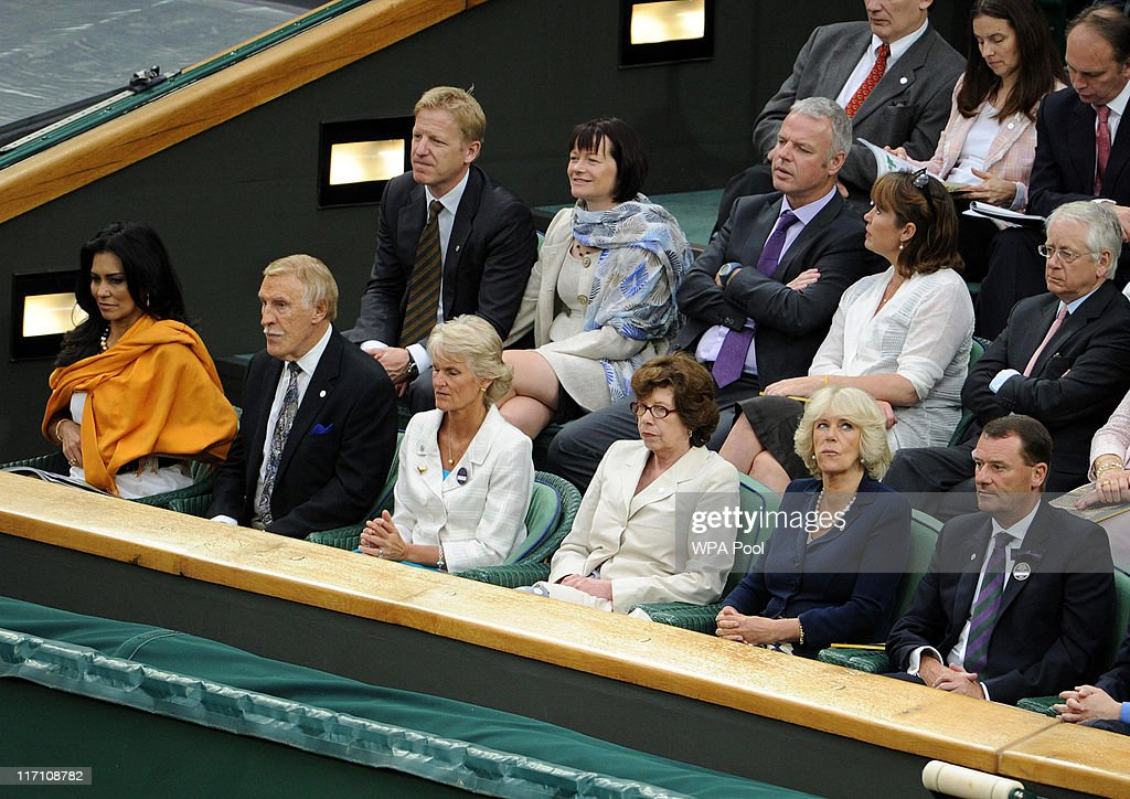 Sir Bruce Forsyth (2nd-L) and his wife Wilnelia (L) sit with (L-R) Mrs Gill Brook, Lady Sarah Keswick, Camilla, Duchess of Cornwall and All England Club Vice Chairman Philip Brook in the Royal Box on Centre Court in the Royal Box on Centre Court during Day Three of the Wimbledon Lawn Tennis Championships at the All England Lawn Tennis and Croquet Club on June 22, 2011 in London, England.