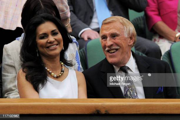 Sir Bruce Forsyth and Wilnelia Merced Lady Forsyth attend the second round match between Venus Williams of the United States and Kimiko DateKrumm of...