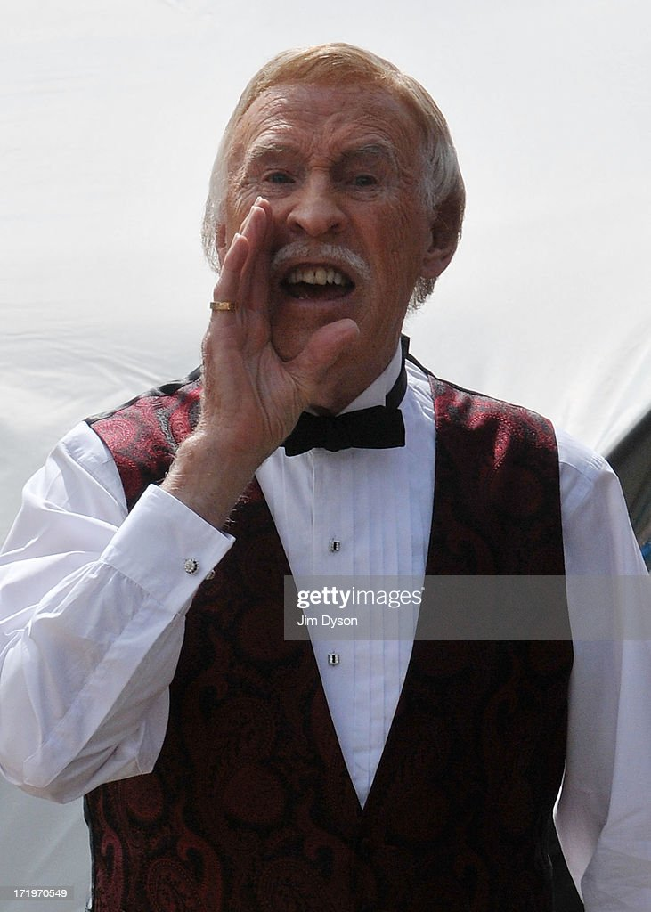 Sir Bruce Forsyth jokes with the press before performing on the Avalon stage during day 4 of the 2013 Glastonbury Festival at Worthy Farm on June 30, 2013 in Glastonbury, England.