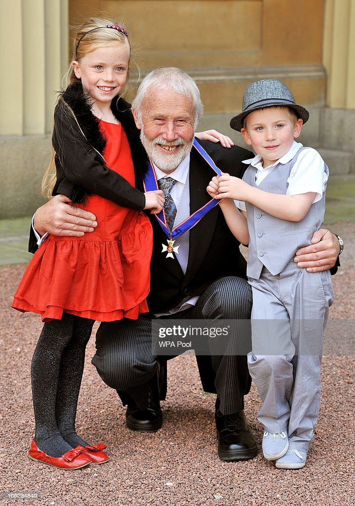 Sir Chris Bonnington (C) poses with his grandchildren Emily, age 8, and Will, age 6, with his CVO (Commander of the Royal Victorian Order) medal received from Queen Elizabeth II during the Royal Investiture ceremony at Buckingham Palace on October 13, 2010 in London, England. Mountaineer Chris Bonnington was honoured for his services to the Outward Bound Trust.