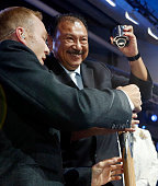 Sir Chris Hoy and President of the Commonwealth Games Federation Prince Imran try to open the Queen's Baton to take out the queen's message during...
