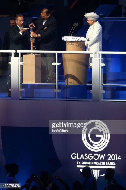 Sir Chris Hoy assists Prince Imran the CGF President attempts to retrieve the message from the baton as he presents it to Queen Elizabeth II Patron...