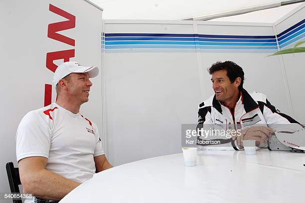 Sir Chris Hoy of Great Britain and Algarve Pro Racing Nissan and Mark Webber of Australia and Porsche Team meet before qualifying for the Le Mans 24...