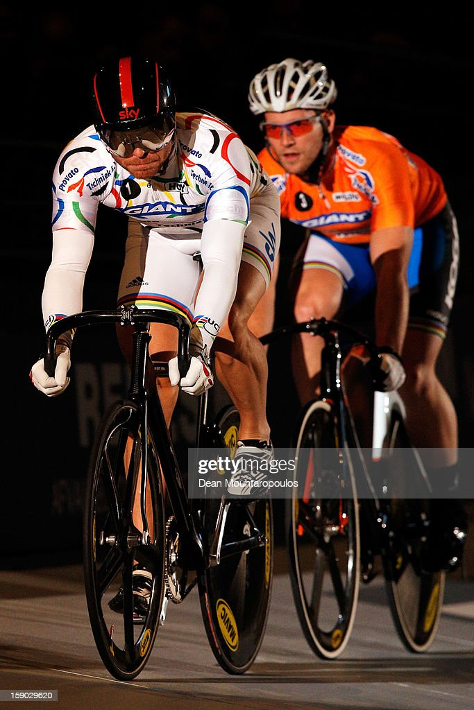 Sir Chris Hoy (L) of Great Britain and Teun Mulder (R) of Netherlands compete in the Giant Sprint Masters during the Rotterdam 6 Day Cycling at Ahoy Rotterdam on January 6, 2013 in Rotterdam, Netherlands.