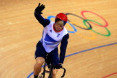 Sir Chris Hoy of Great Britain celebrates winning the Men's Keirin Track Cycling First Round heat on Day 11 of the London 2012 Olympic Games at...