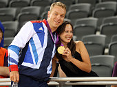 Sir Chris Hoy of Great Britain celebrates with his wife Sarra Hoy and his gold medal after setting a new world record in the Men's Team Sprint Track...