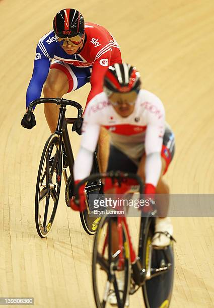 Sir Chris Hoy of Great Britain competes against Seiichiro Nakagawa of Japan in the Men's Sprint Quarter Finals during the UCI Track Cycling World Cup...