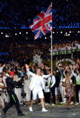 Sir Chris Hoy of the Great Britain Olympic cycling team carries his country's flag during the Opening Ceremony of the London 2012 Olympic Games at...