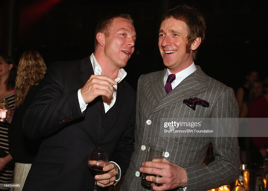 Sir <a gi-track='captionPersonalityLinkClicked' href=/galleries/search?phrase=Chris+Hoy&family=editorial&specificpeople=171259 ng-click='$event.stopPropagation()'>Chris Hoy</a> shares a joke with <a gi-track='captionPersonalityLinkClicked' href=/galleries/search?phrase=Bradley+Wiggins&family=editorial&specificpeople=182490 ng-click='$event.stopPropagation()'>Bradley Wiggins</a> at the <a gi-track='captionPersonalityLinkClicked' href=/galleries/search?phrase=Bradley+Wiggins&family=editorial&specificpeople=182490 ng-click='$event.stopPropagation()'>Bradley Wiggins</a> Foundation 'The Yellow Ball' event at The Roundhouse on October 16, 2012 in London, England. The dinner and entertainment show was held to celebrate the historic achievements of Great Britain's cyclist <a gi-track='captionPersonalityLinkClicked' href=/galleries/search?phrase=Bradley+Wiggins&family=editorial&specificpeople=182490 ng-click='$event.stopPropagation()'>Bradley Wiggins</a> in 2012, including his Tour de France win and Olympic gold achievements. The Foundation aims to promote participation in sport, to encourage young people to exercise regularly, and to support athletes from all sports to take their talent to the next level.