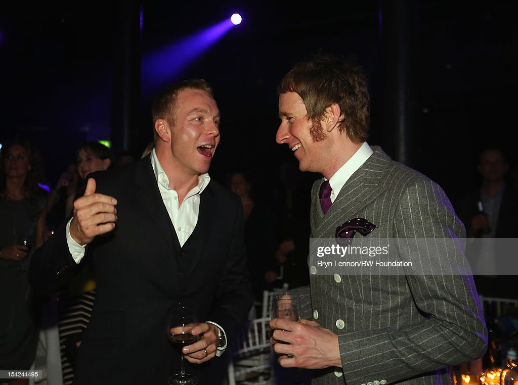 Sir Chris Hoy shares a joke with Bradley Wiggins at the Bradley Wiggins Foundation 'The Yellow Ball' event at The Roundhouse on October 16, 2012 in London, England. The dinner and entertainment show was held to celebrate the historic achievements of Great Britain's cyclist Bradley Wiggins in 2012, including his Tour de France win and Olympic gold achievements. The Foundation aims to promote participation in sport, to encourage young people to exercise regularly, and to support athletes from all sports to take their talent to the next level.