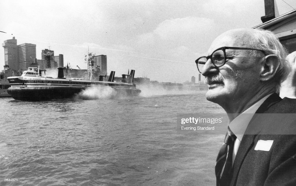 Sir Christopher Cockerell watches the 'Princess Margaret' the British Hovercraft Corporations latest craft roar up the Thames