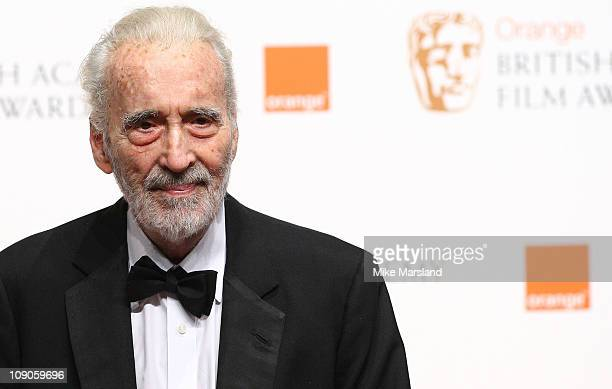 Sir Christopher Lee poses in front of the winners boards at the Orange British Academy Film Awards 2011 held at The Royal Opera House on February 13...