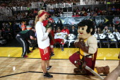 Sir Cleveland Cavalier Mascot of Cleveland Cavaliers give Actress Erin Heatherton of the West Team roses during the Sprint NBA AllStar Celebrity Game...