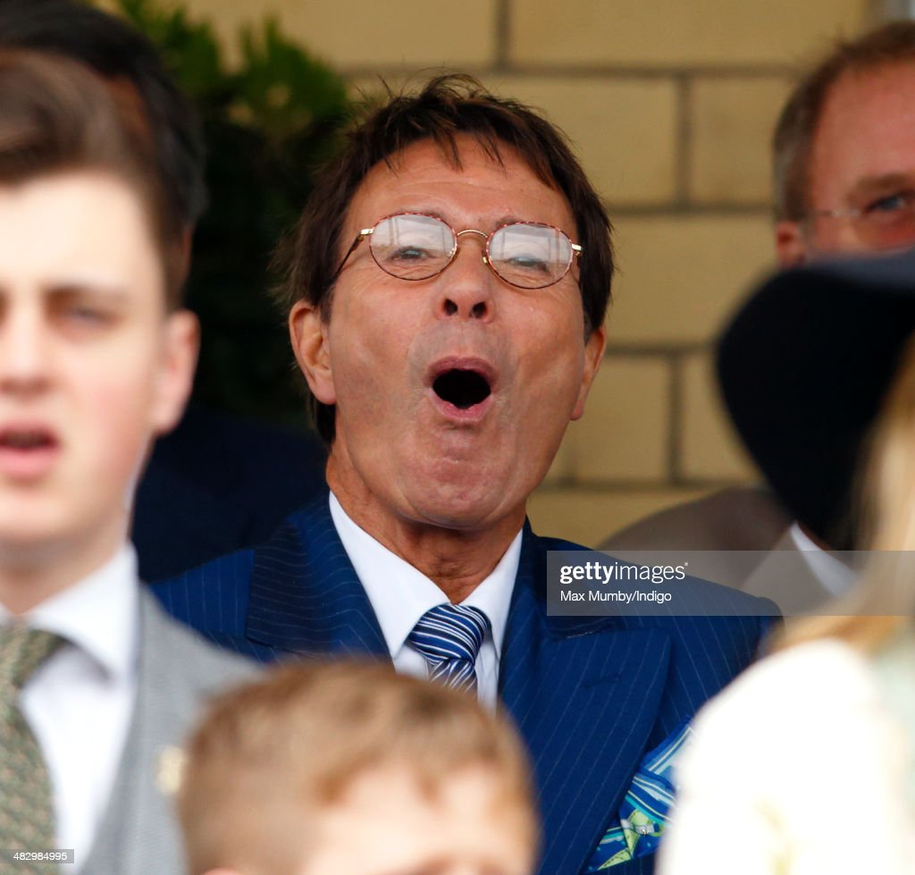 Sir <a gi-track='captionPersonalityLinkClicked' href=/galleries/search?phrase=Cliff+Richard&family=editorial&specificpeople=158267 ng-click='$event.stopPropagation()'>Cliff Richard</a> cheers whilst watching the racing as he attends the Crabbie's Grand National horse racing meet at Aintree Racecourse on April 5, 2014 in Liverpool, England.