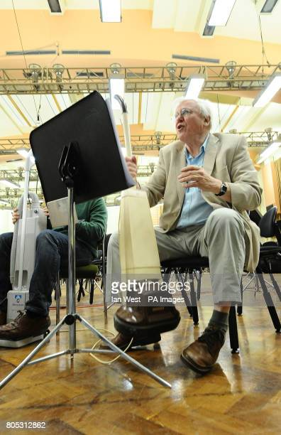 Sir David Attenborough with a floor polisher during a rehearsal for Sir Malcolm Arnold's 'A Grand Grand Overture' which will open the second half of...