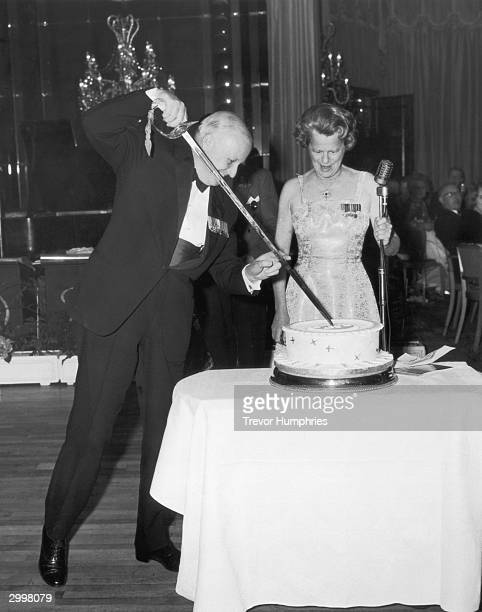Sir David Lee Air Member for Personnel cuts the cake at the 25th Anniversary Battle Of Britain Ball held at the Dorchester Hotel 1st October 1965...