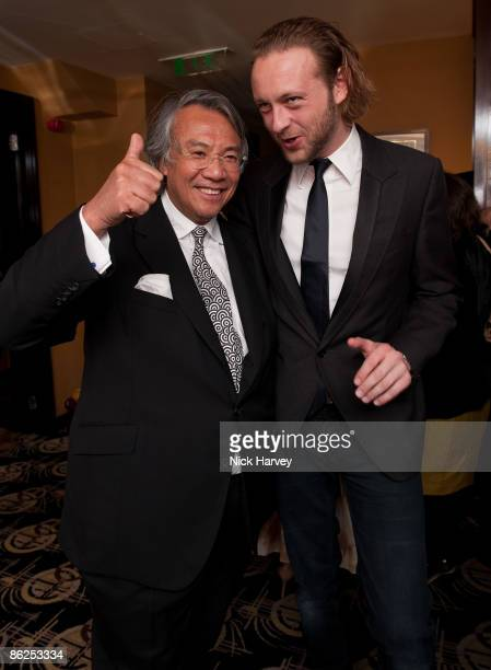 Sir David Tang and Lord Edward SpencerChurchill attend a dinner for Michael Kors at China Tang at the Dorchester on April 27 2009 in London England