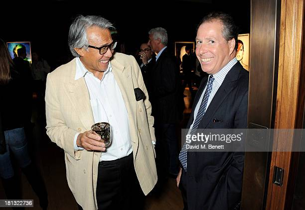 Sir David Tang and Viscount David Linley attends a private view of 'Kate Moss The Collection' at Christie's King Street on September 20 2013 in...