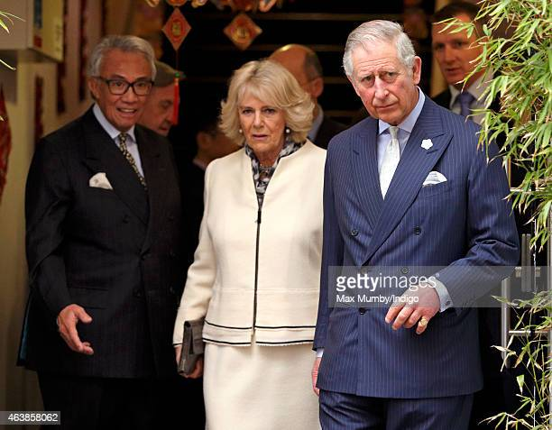 Sir David Tang Camilla Duchess of Cornwall and Prince Charles Prince of Wales visit Chinatown to mark Chinese New Year on February 19 2015 in London...