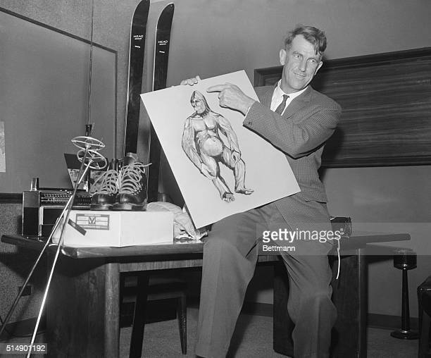 Sir Edmund Hillary conqueror of Mount Everest shows newsmen here 1/27 of an Abominable Snowman which he hoped to capture on the next expedition to...