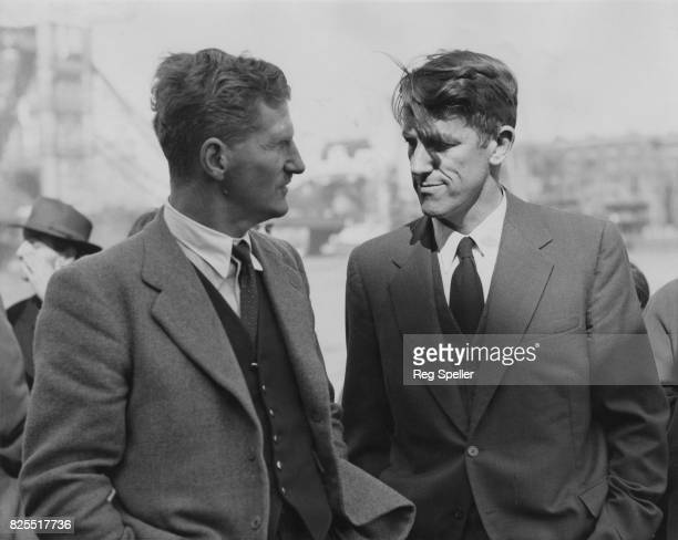 Sir Edmund Hillary is met by Sir John Hunt at Butler's Wharf London after his return from the British TransAntarctic Expedition on the 'Theron' 23rd...