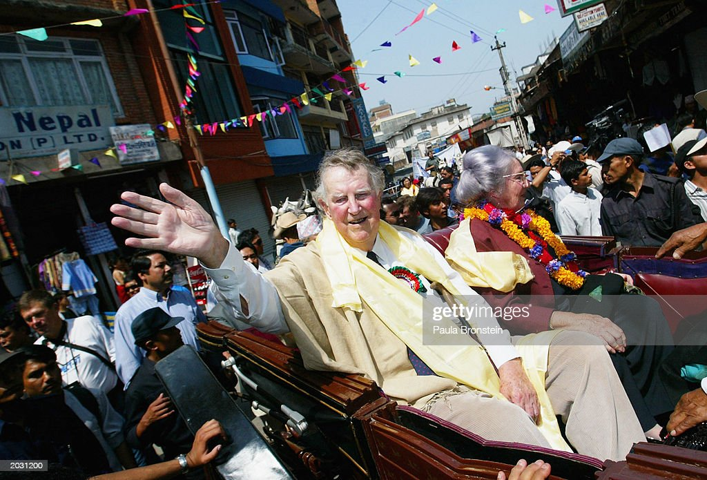 Sir Edmund Hillary, one of the first two men to climb Mount Everest, waves to the public during a procession celebrating the 50th anniversary of the ascent of the world's highest mountain on May 27, 2003 in Kathmandu, Nepal. Hillary and Nepali sherpa Tenzing Norgay climbed the 29,035-foot Everest summit on May 29, 1953. A record 1,000 climbers plan assaults on the summit as mountaineers celebrate the 50-year anniversary of the conquest of Everest.