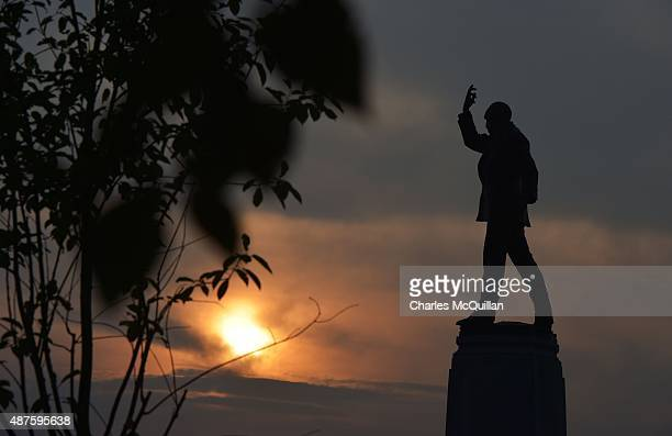 Sir Edward Carson's statue can be seen as the sun sets at Stormont on September 10 2015 in Belfast Northern Ireland A political crisis has erupted in...