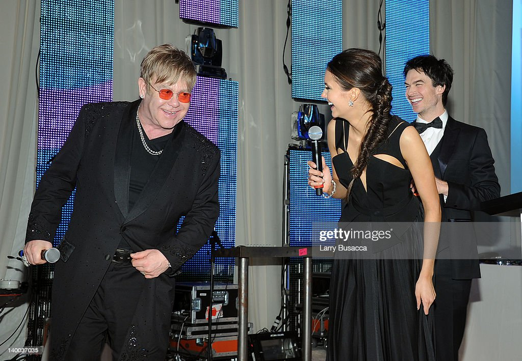 Sir Elton John and actors Nina Dobrev and Ian Somerhalder attend the 20th Annual Elton John AIDS Foundation Academy Awards Viewing Party at The City of West Hollywood Park on February 26, 2012 in Beverly Hills, California.