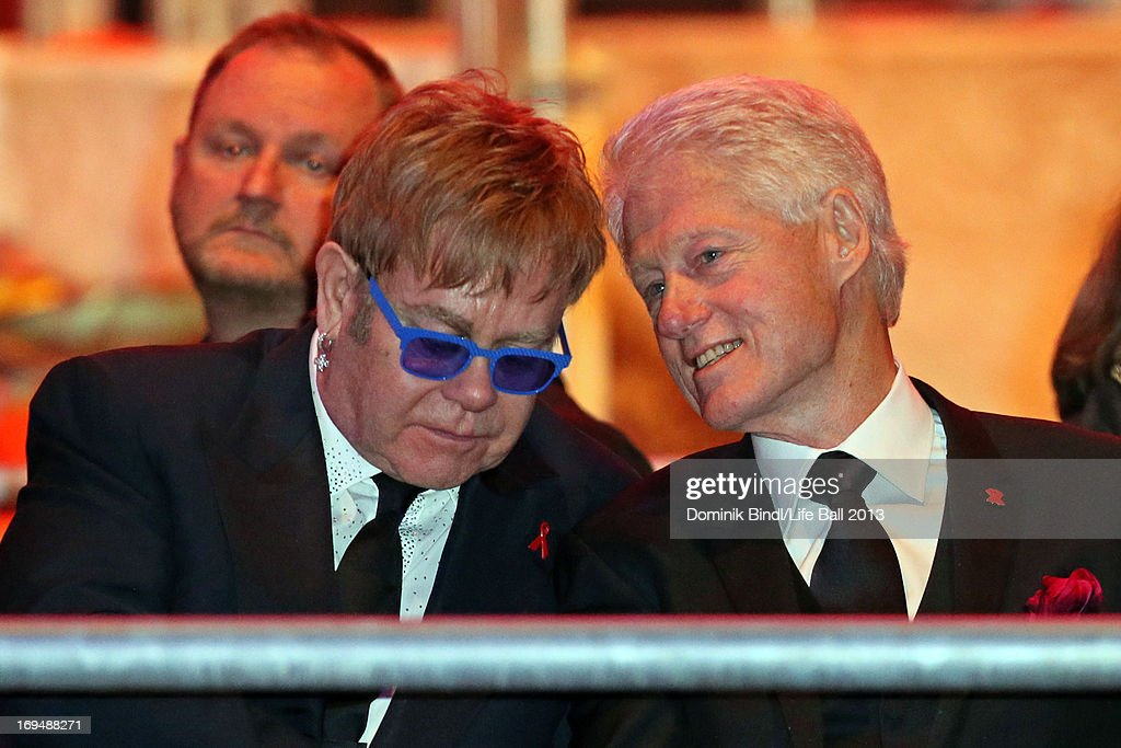 Sir <a gi-track='captionPersonalityLinkClicked' href=/galleries/search?phrase=Elton+John&family=editorial&specificpeople=171369 ng-click='$event.stopPropagation()'>Elton John</a> (L) and <a gi-track='captionPersonalityLinkClicked' href=/galleries/search?phrase=Bill+Clinton&family=editorial&specificpeople=67203 ng-click='$event.stopPropagation()'>Bill Clinton</a> during the 'Life Ball 2013 - Show' at City Hall on May 25, 2013 in Vienna, Austria.