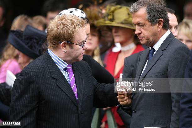 Sir Elton John and celebrity photographer Mario Testino after the Service of Thanksgiving for the life of Diana Princess of Wales at the Guards'...