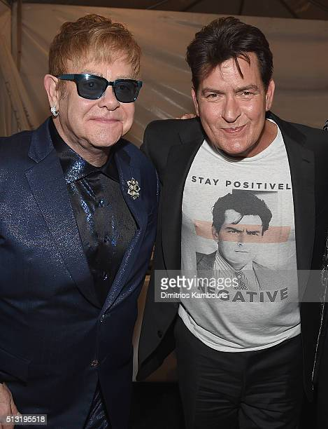 Sir Elton John and Charlie Sheen attend the 24th Annual Elton John AIDS Foundation's Oscar Viewing Party at The City of West Hollywood Park on...