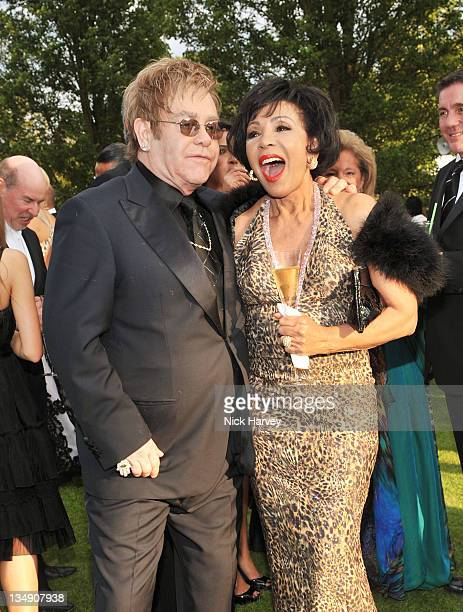 Sir Elton John and Dame Shirley Bassey attend The 12th Annual White Tie and Tiara Ball to Benefit Elton John AIDS Foundation in Association with...