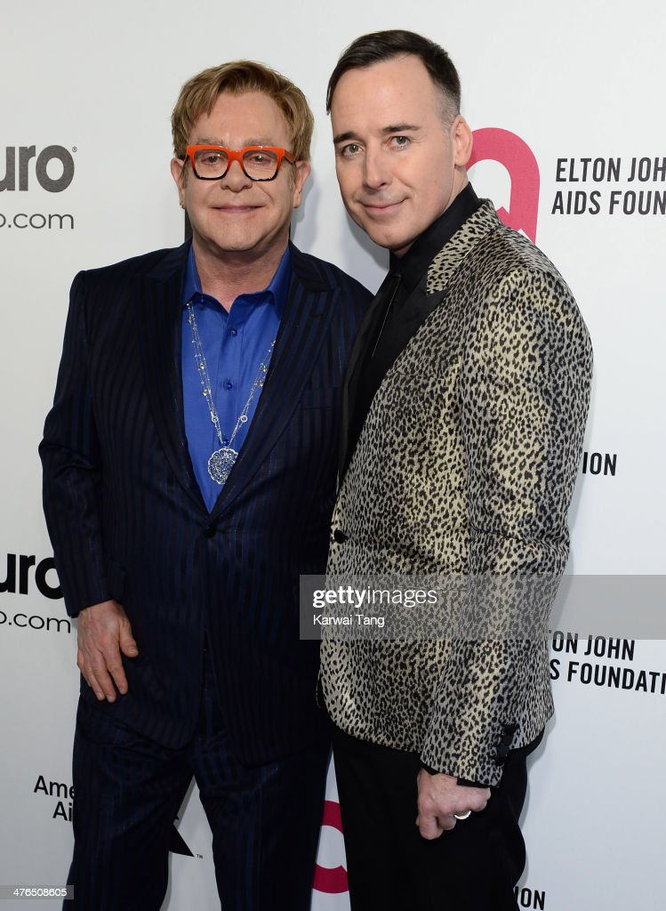 Sir <a gi-track='captionPersonalityLinkClicked' href=/galleries/search?phrase=Elton+John&family=editorial&specificpeople=171369 ng-click='$event.stopPropagation()'>Elton John</a> and <a gi-track='captionPersonalityLinkClicked' href=/galleries/search?phrase=David+Furnish&family=editorial&specificpeople=220203 ng-click='$event.stopPropagation()'>David Furnish</a> arrive for the 22nd Annual <a gi-track='captionPersonalityLinkClicked' href=/galleries/search?phrase=Elton+John&family=editorial&specificpeople=171369 ng-click='$event.stopPropagation()'>Elton John</a> AIDS Foundation's Oscar Viewing Party held at West Hollywood Park on March 2, 2014 in West Hollywood, California.