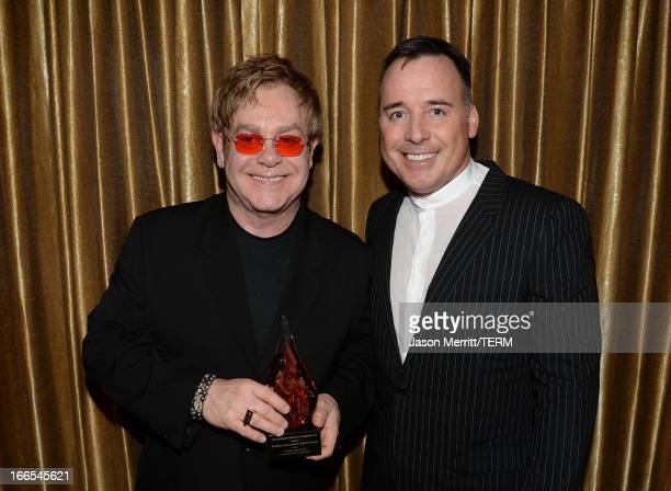 Sir Elton John and David Furnish attend as honored guests at the American Fertility Association Illuminations LA 2013 on April 13 2013 in Beverly...
