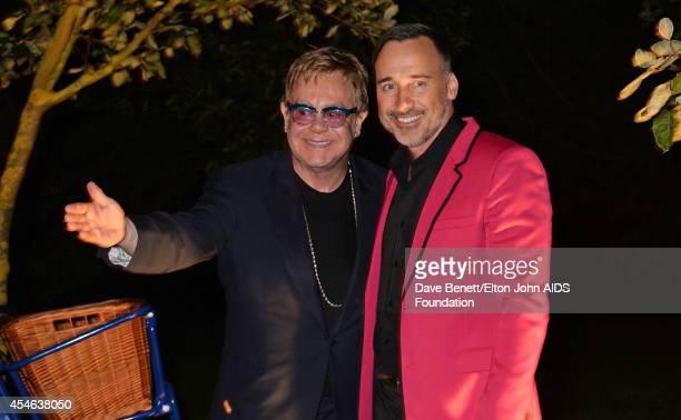 APPLIES Sir Elton John and David Furnish attend La Nuit Des Etoiles night club at the Woodside End of Summer party to benefit the Elton John AIDS...
