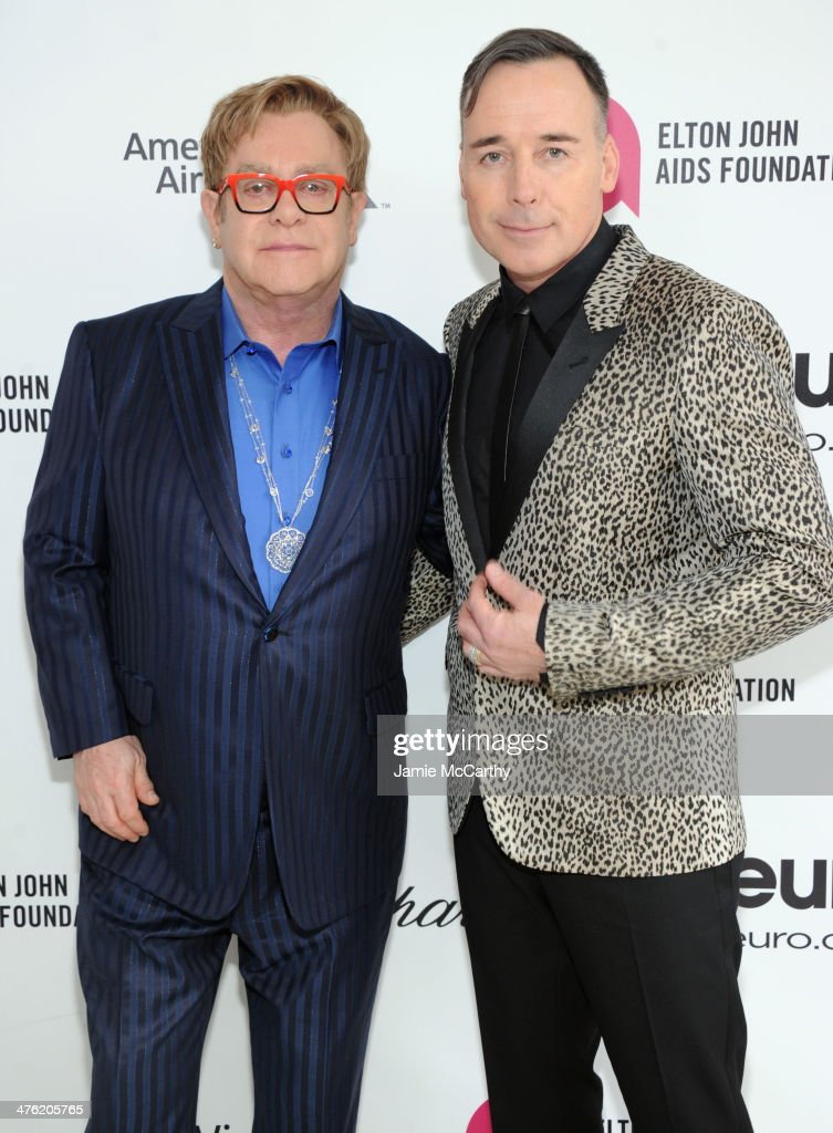 Sir Elton John (L) and David Furnish attend the 22nd Annual Elton John AIDS Foundation Academy Awards Viewing Party at The City of West Hollywood Park on March 2, 2014 in West Hollywood, California.