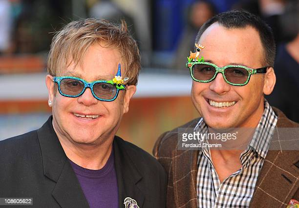 Sir Elton John and David Furnish attend the UK premiere of 'Gnomeo Juliet' at Odeon Leicester Square on January 30 2011 in London England