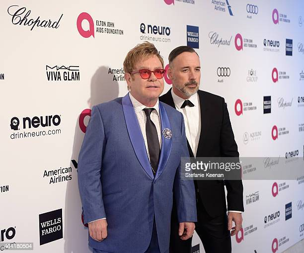Sir Elton John and David Furnish both wearing Chopard attend the 23rd Annual Elton John AIDS Foundation Academy Awards viewing party with Chopard on...
