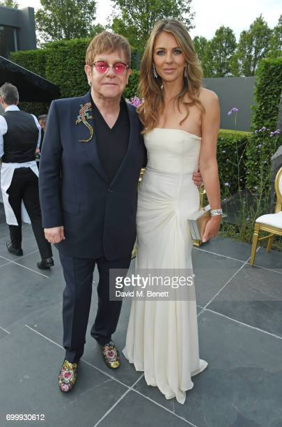 Sir Elton John and Elizabeth Hurley attend the Woodside Gallery Dinner in benefit of Elton John AIDS Foundation in partnership with BVLGARI at...
